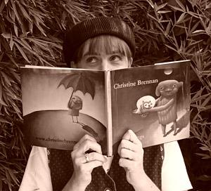 christine-brennan-holding-book